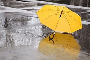 yellow umbrella in rain