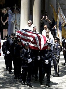Pallbearers carry a casket covered by the United States flag following funeral services for Jersey City Police Department officer Melvin Santiago