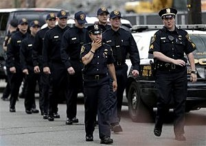 Police cadets march in a line as they arrive at McLaughlin Funeral Home during visitation hours for Jersey City Police Department officer Melvin Santiago