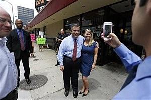 Gov. Chris Christie poses for a snapshot in Denver