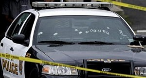 A Jersey City Police Department cruiser is seen with bullet holes on the windshield