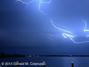 LIghtning flashes over the Shark River in Neptune City looking towards Wall