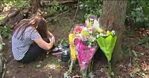 A friend grieves at the site where two Randolph High School football players died in a car crash