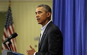 President Barack Obama speaks to reporters