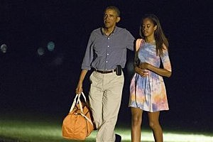 President Barack Obama walks with his daughter Malia as he arrives on the South Lawn of the White House