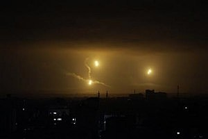 Flares light up the sky over Gaza City