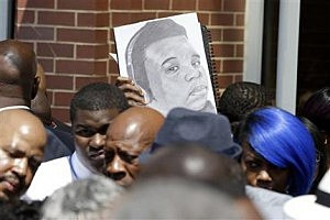 A sketch showing Michael Brown is seen as people gather outside of Friendly Temple Missionary Baptist Church during the funeral for Michael Brown in St Louis