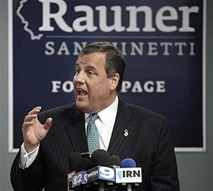 New Jersey Gov. Chris Christie, center, speaks with campaign volunteers during a stop at Republican gubernatorial candidate Bruce Rauner's Chicago campaign headquarters