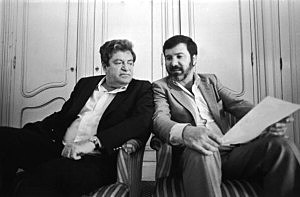 Israeli film producers Menachem Golan and Yoram Globus sit shoulder to shoulder in 1983.