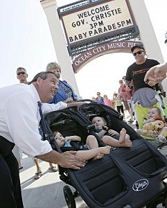 """Governor Chris Christie poses with baby parade babies after holding a """"Conversation Down the Shore"""" town hall on the boardwalk in Ocean City"""