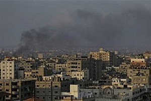 Smoke from a fire caused by an Israeli strike rises over Gaza City, Gaza Strip