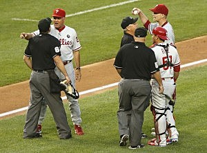 Manager Ryne Sandberg #23 (2nd L) of the Philadelphia Phillies and his starting pitcher A.J. Burnett #34 (TOP R) argue with umpires after their ejections