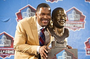 Former New York Giants defensive end Michael Strahan with his bust during the NFL Class of 2014 Pro Football Hall of Fame Enshrinement Ceremony in Canton, Ohio.
