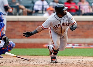 Pablo Sandoval #48 of the San Francisco Giants hits a RBI sngle in the ninth inning to break a 3-3 tie against the New York Mets at Citi Field