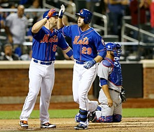 David Wright #5 of the New York Mets congratulates teammate Eric Campbell after Campbell his a homerun in the fourth inning.