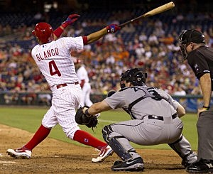 Andres Blanco #4 of the Philadelphia Phillies hits a three-run home run in the bottom of the fifth inning