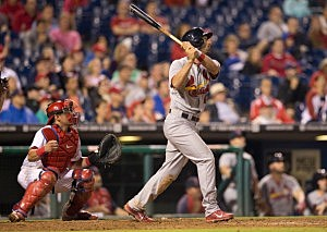 Cardinals third baseman Matt Carpenter #13 of the St. Louis Cardinals hits a sacrifice fly in the top of the twelfth inning which lead to the eventual winning run against the Philadelphia Phillies