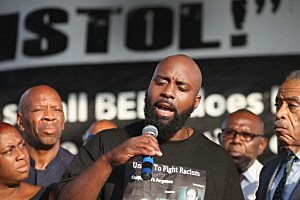 Michael Brown Sr. speaks at the Peace Fest music festival in St. Louis' Forest Park