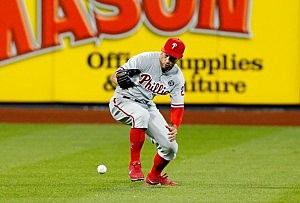 Grady Sizemore #24 of the Philadelphia Phillies commits a seventh inning two-run error on a ball hit by Juan Lagares #12 of the New York Mets