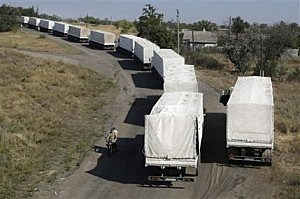 Trucks marked as being from a bitterly disputed Russian aid convoy to Ukraine stand in line as they return to Russia on the border post at Izvaryne, eastern Ukraine