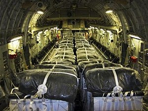This image released by the U.S. Air Force, shows pallets of bottled water loaded aboard a U.S. Air Force C-17 Globemaster III aircraft in preparation for a humanitarian airdrop over Iraq,