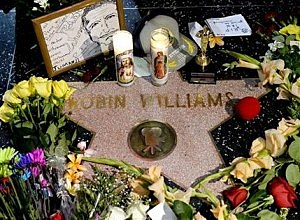 Flowers are placed in memory of actor/comedian Robin Williams on his Walk of Fame star