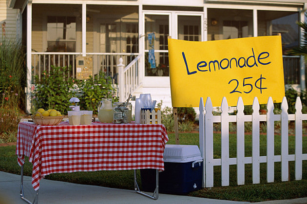 Lemonade stand in front of a house