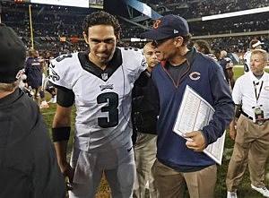 Chicago Bears coach Marc Trestman, right, talks to Philadelphia Eagles quarterback Mark Sanchez