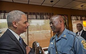 Attorney General Eric Holder speaks with Capt. Ron Johnson of the Missouri State Highway Patrol