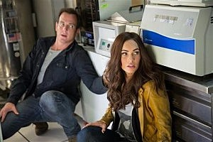"Will Arnett, left, and Megan Fox in a scene from ""Teenage Mutant Ninja Turtles."""