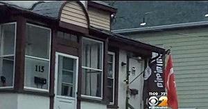 Islamic flag hanging from Mark Dunaway's Garwood home