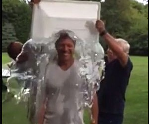 Gov. Chris Christie (L) and Patriots owner Robert Kraft pour water over Jon Bon Jovi for the ALS Ice Bucket Challenge