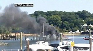 Boat after exploding during refueling in a Long Island harbor