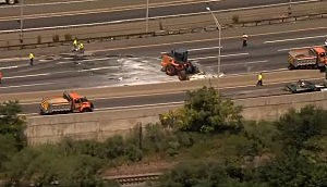 Crews clean up broken glass on the New Jersey Turnpike near exit #12