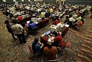 People signing up for unemployment fill a room at the Atlantic City Convention Center in Atlantic City