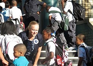 Newark School Superintendent Cami Anderson, second form left, welcomes students to the first day of classes at Peshine Avenue School in Newark