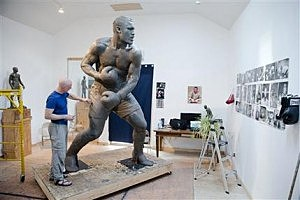 Artist Stephen Layne works on a sculpture of boxing heavyweight champion Joe Frazier in Philadelphia.