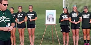 Members of the Mainland High School soccer team at a vigil for Aisling Cooke.