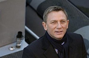 Daniel Craig smiles for photographers as he films a scene for the new James Bond film, Spectre, in London