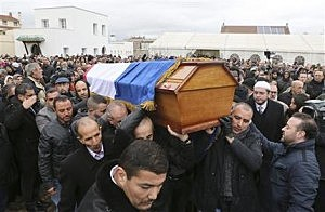 People carry the coffin of slain police officer Ahmed Merabet, a victim of the  Charlie Hebdo attack, after a funeral service at the Bobigny Mosque, east of Paris, France