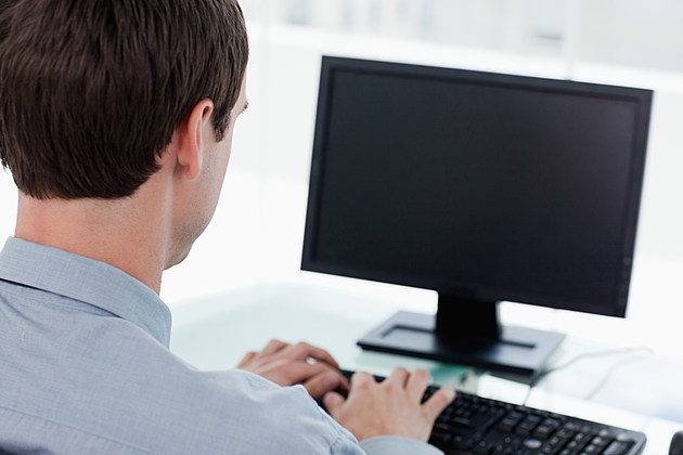 Back view of a businessman working with a computer