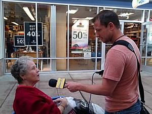 Dino Flammia speaking with shopper