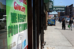 """NEW YORK, NY - SEPTEMBER 19:  A grocery store advertises that they accept food stamps in the South Bronx on September 19, 2013 in New York City.  According to the 2010 U.S. Census Bureau report, over a quarter-million people in the South Bronx are living in poverty, making the 16th Congressional District the poorest in the nation. New Census Bureau numbers for all of New York City show that the poverty rate has risen to 21.2 percent in 2012, from 20.9 percent the year before. As New Yorkers prepare to vote for their next mayor following Michael Bloomberg, the Democratic candidate Bill de Blasio has focused on the theme that New York has transformed into a """"tale of two cities"""" under the Bloomberg administration.  (Photo by Spencer Platt/Getty Images)"""