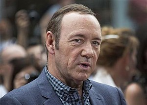 FILE - In a Monday, June 9, 2014 file photo, U.S. actor Kevin Spacey arrives for the European Premiere of Now, at a cinema in central London. The American actor's appearance at the World Economic Forum on Friday, Jan 22, 2016 drew some of the largest interest so far at the Davos event, with long queues of high-power business executives hoping to attend his closed-door event, which focused on the theatricality of American politics and his career.  (Photo by Joel Ryan/Invision/AP, File)