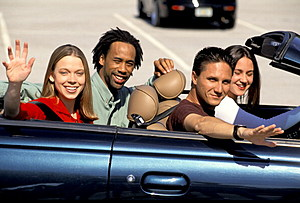 Four Teens And Young Adults In Convertible.