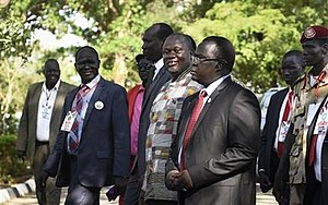 South Sudan's rebel leader and now Vice President Riek Machar, center, walks to be sworn in at the presidential palace in the capital Juba, South Sudan Tuesday, April 26, 2016. (AP Photo/Jason Patinkin)