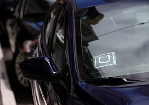 SAN FRANCISCO, CA - JUNE 12: A sticker with the Uber logo is displayed in the window of a car on June 12, 2014 in San Francisco, California. The California Public Utilities Commission is cracking down on ride sharing companies like Lyft, Uber and Sidecar by issuing a warning that they could lose their ability to operate within the state if they are caught dropping off or picking up passengers at airports in California. (Photo by Justin Sullivan/Getty Images)