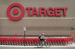 CHICAGO - MAY 23: A bicyclist rides past a row of shopping carts outside a Target store on May 23, 2007 in Chicago, Illinois. Today, Target reported an 18 per cent increase in their quarterly earnings, beating analysts' expectations. (Photo by Scott Olson/Getty Images)