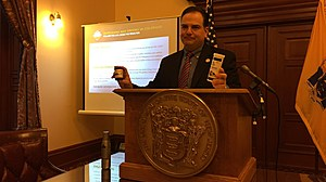 Sen. Nicholas Scutari holds up packaging for edible marijuana products sold in Colorado. (Michael Symons/Townsquare Media NJ)