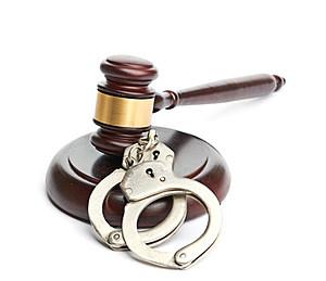 handcuffs and gavel (merznatalia, ThinkStock)